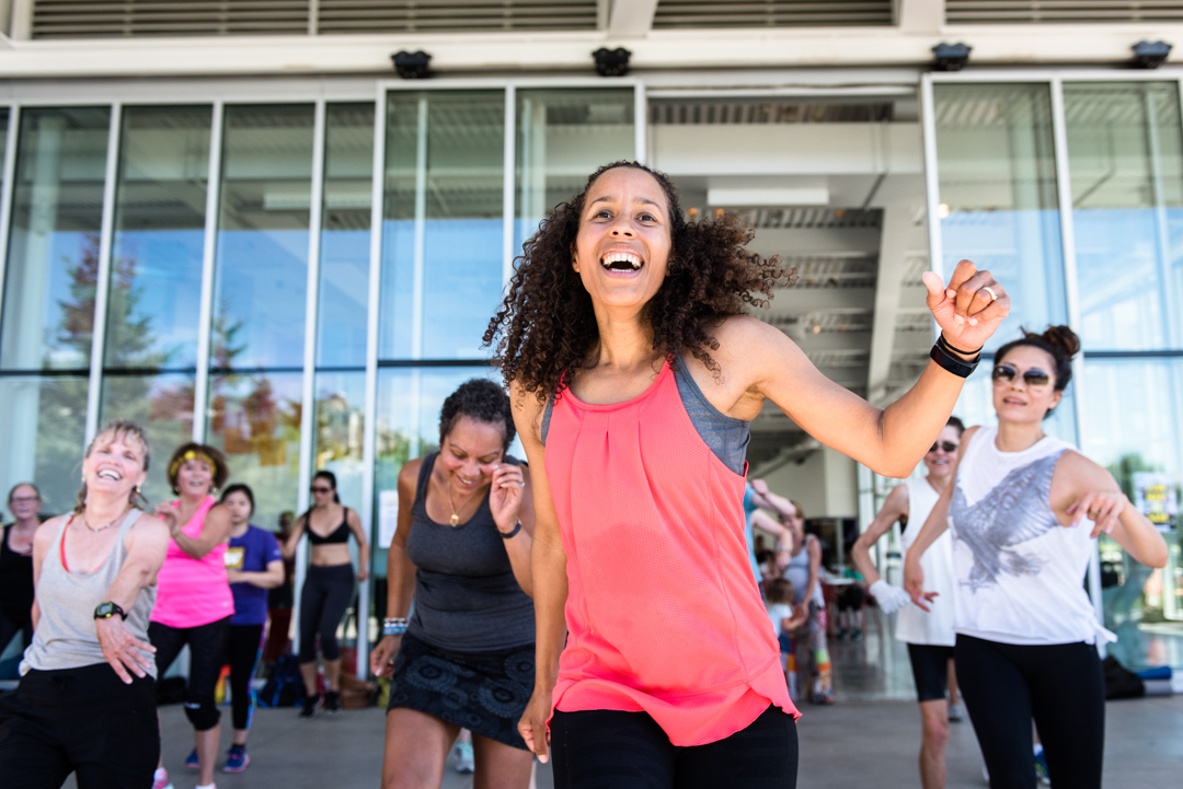 Woman leads Zumba class at Summer at SAM