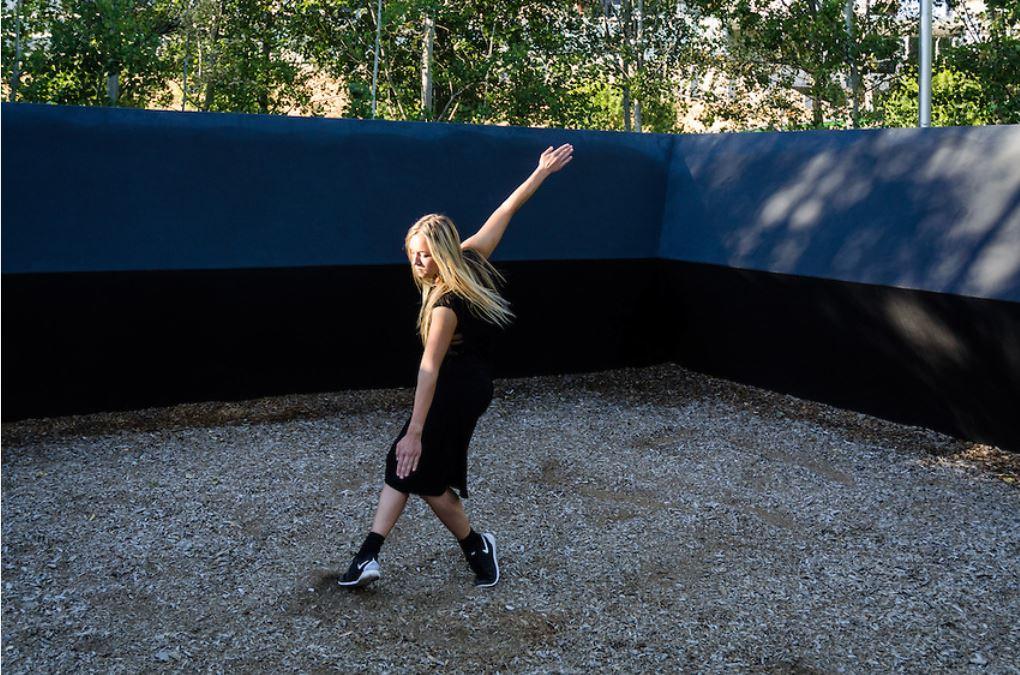 modern dancer inside large sculpture