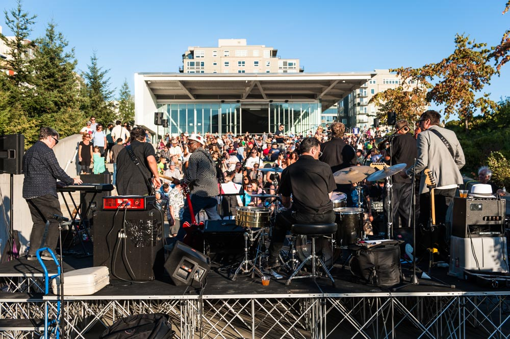 band performing outdoors with crowd